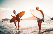 Happy Surfer Couple Running Wi...