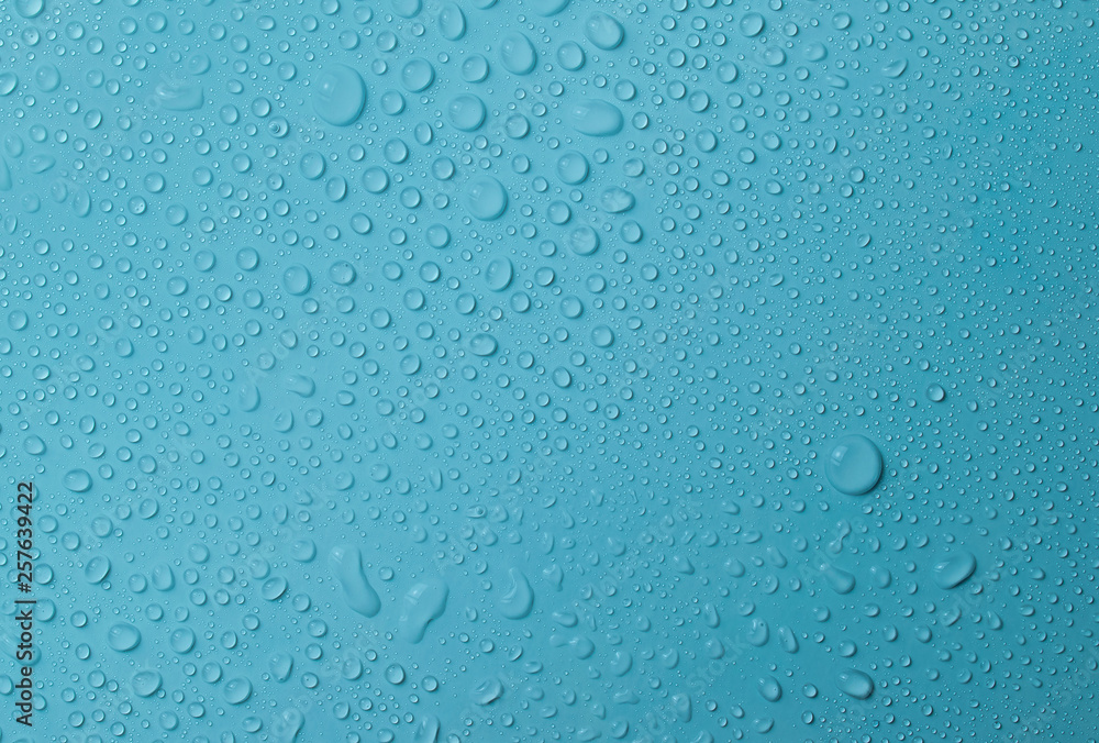 Fototapety, obrazy: Drops of water on a blue glass texture background