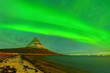 Leinwanddruck Bild - View of the northern light at night at Kirkjufell Mountain in Iceland.