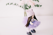 A Handmade Doll With Long Brow...