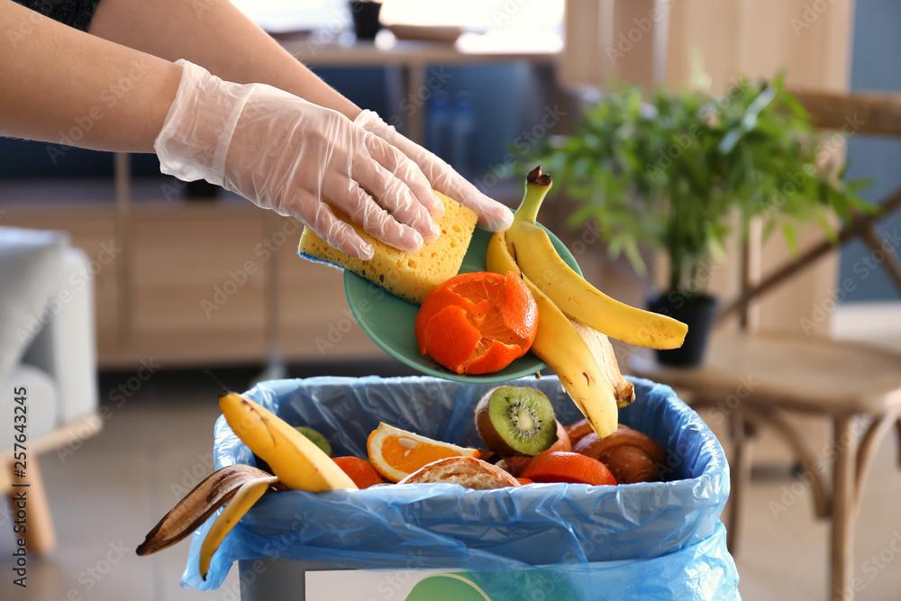 Fototapety, obrazy: Woman throwing garbage into trash bin