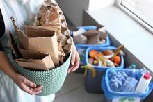 Woman Holding Trash Bin With P...