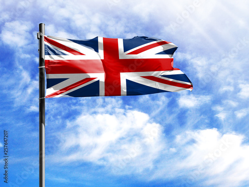 Pinturas sobre lienzo  National flag of United Kingdom on a flagpole in front of blue sky