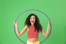 Photo Of Energetic Woman 20s Wearing Summer Clothes Doing Exercises With Hula Hoop During Gymnastics