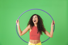 Photo Of Delighted Woman 20s Wearing Summer Clothes Doing Exercises With Hula Hoop During Gymnastics