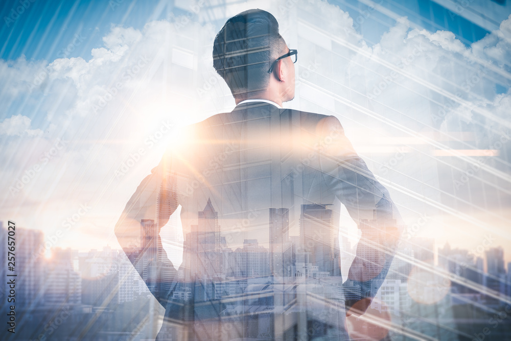 Fototapety, obrazy: The double exposure image of the businessman standing back during sunrise overlay with cityscape image. The concept of modern life, business, city life and internet of things.
