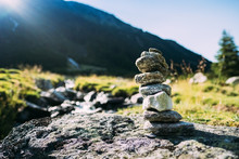 Little Cairn On A Meadow In The Tyrolean Alps.