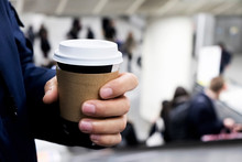 Man Having A Takeout Cup Of Coffee