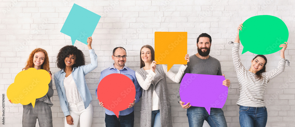 Fototapeta Group of diverse people holding colorful speech bubbles