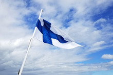 White Flag With Blue Cross On Blue Sky Background