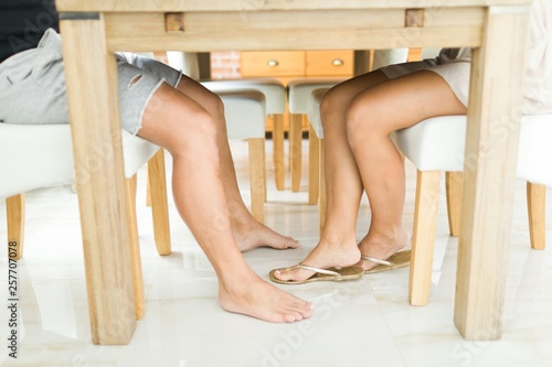 Man S And Woman Legs Under Table