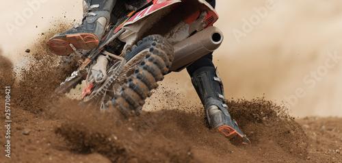 Obraz na plátně Rider driving in the motocross race the rear wheel motocross bike