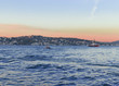 fishing boat in Istanbul Strait. sailing boat at sunset.