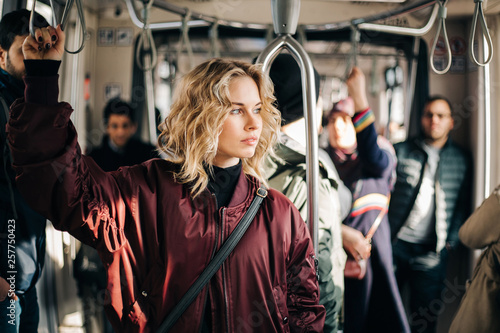 Image of curly blonde riding in bus.