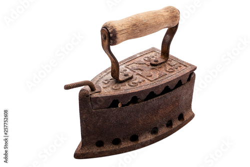 Canvastavla Close up of an antique and rusty iron from coal ironing with wooden handle, isolated on white background