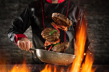 Closeup Of Chef Throwing Hambu...