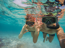 Selfie Of Young Couple Snorkeling In The Sea. Making Everything Ok Symbol