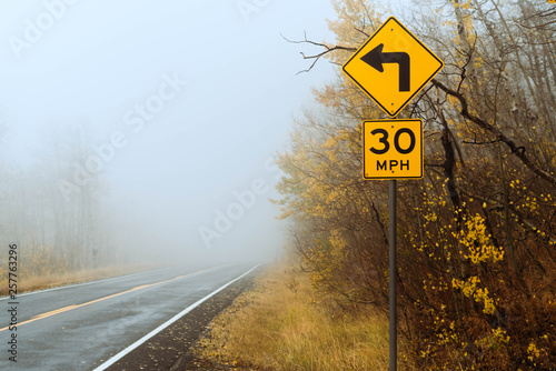 Foggy Street Signs Fototapeta