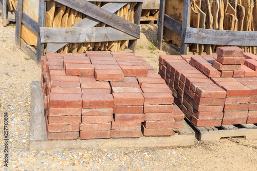 Photo Rust or Red Stone Ashlars on a Palette  Palette of Red or Rust Stone ashlars or bricks used for construction and landscaping