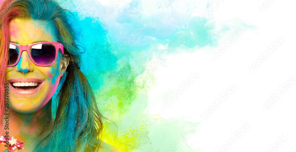 Fototapeta Beautiful joyful young woman celebrating the Holi festival. Colors festival. Beauty spring concept