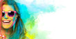 canvas print picture - Beautiful joyful young woman celebrating the Holi festival. Colors festival. Beauty spring concept
