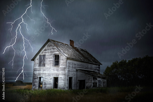 Deurstickers Nacht heavy lightning and thunder storm close to abandoned house.