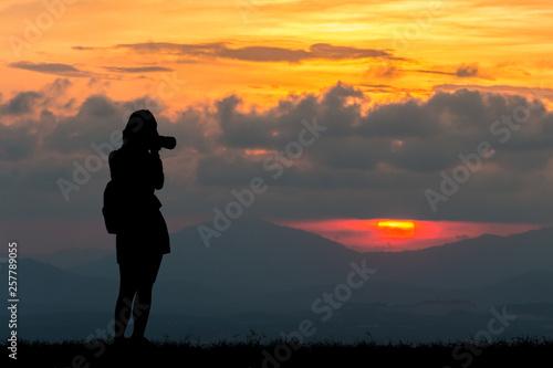 Aluminium Prints Red Silhouette women at sunset