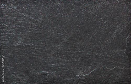 Obraz na plátně  Dark grey black slate stone background or texture