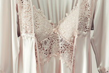 Lace Nightgown And Cream Silk Robe On Pink Background