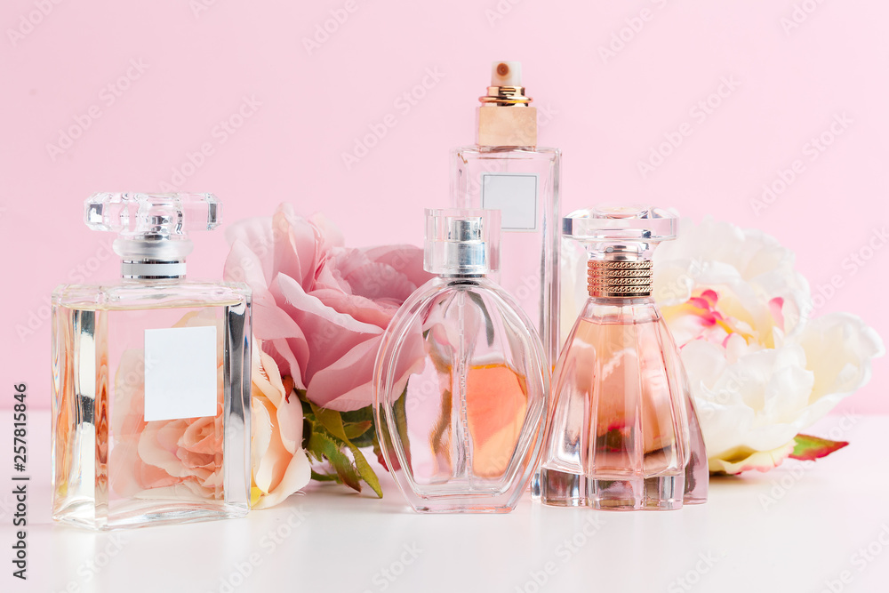 Fototapety, obrazy: Bottle of perfume with flowers on color background