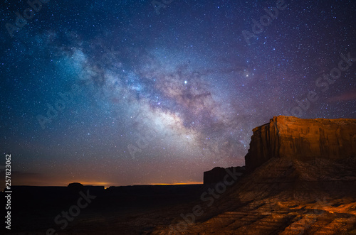 Foto op Plexiglas Chocoladebruin Milky Way above Monument Valley, Utah, USA