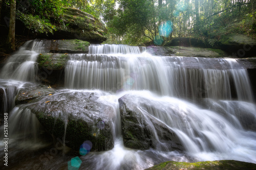 Recess Fitting Waterfalls Photography of waterfall in the green forest flowing on the rocks.