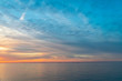 The colorful sky at sunset is reflected in the sea. Seascape with sunset.