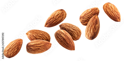 Photo Flying almond isolated on white background with clipping path