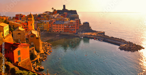 Fotografie, Tablou Vernazza village with typical colorful multicolored buildings houses, Castello D