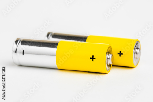 Photo AA alkaline batteries on white background.