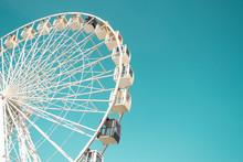 Big City Ferris Wheel On A Background Of Clean Blue Sky