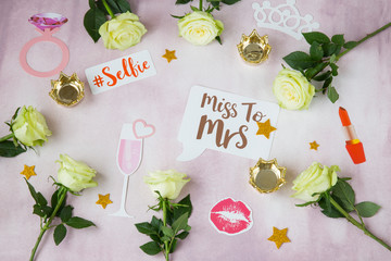 on a pink background, roses and pictures for a bachelorette party: a glass, lipstick, kiss, ring, stars, inscriptions