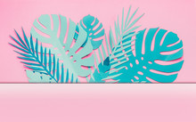Various Turquoise Blue Tropical Leaves Frame Or Border With Copy Space For Your Design On Pastel Pink Background. Creative Layout Made With Papercraft