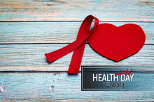 World Health Day, Healthcare And Medical Concept, Red Ribbon And Red Heart On The Blue Wooden Background