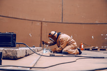 Worker In Protective Suit And ...