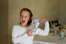 Girl Found It. Afikoman Is A Half-piece Of Matzo Which Is Broken Of The Passover Seder.In Many Families The Father Takes The Afikoman And Hides It.The Child That Finds The Afikoman Receives Gift.