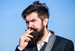 Looking for inspiration. Businessman against the sky. brutal caucasian hipster with moustache. Bearded man smoking cigarette. smoke. Future success. Male formal fashion. Mature hipster with beard