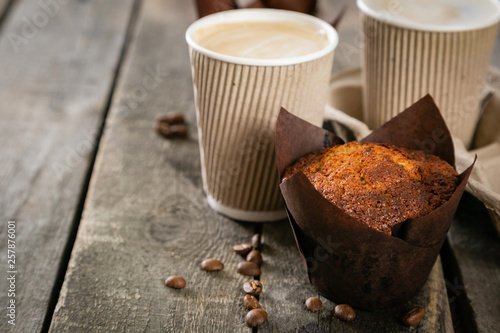 Canvas Print Coffee to go with muffin on wood background, copy space