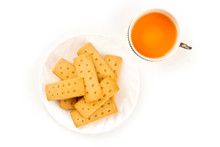 A Closeup Photo Of Scottish Shortbread Butter Cookies, Shot From The Top On A White Background With A Cup Of Tea And Copy Space