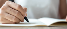 Businesswoman Writing On Notebook In Office, Hand Of Woman Holding Pen With Signature On Paper Report. Business Concepts