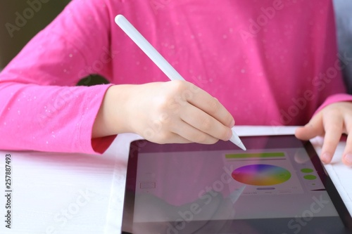 drawing games tablet White Child Hand Drawing On Tablet Screen With White Pencil