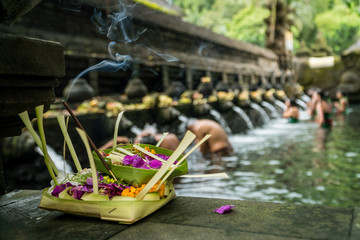 The holy spring water of Pura Tirta Empul temple in Bali, Indonesia.