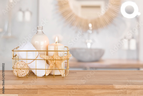 Acrylic Prints Spa Basket with spa products on wood over blurred bathroom interior