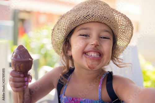Obraz Girl smiling with her mouth smeared with ice cream - fototapety do salonu